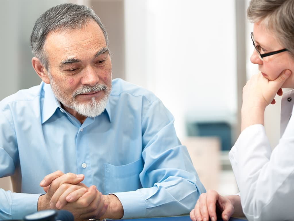 ALS patient talking to a doctor