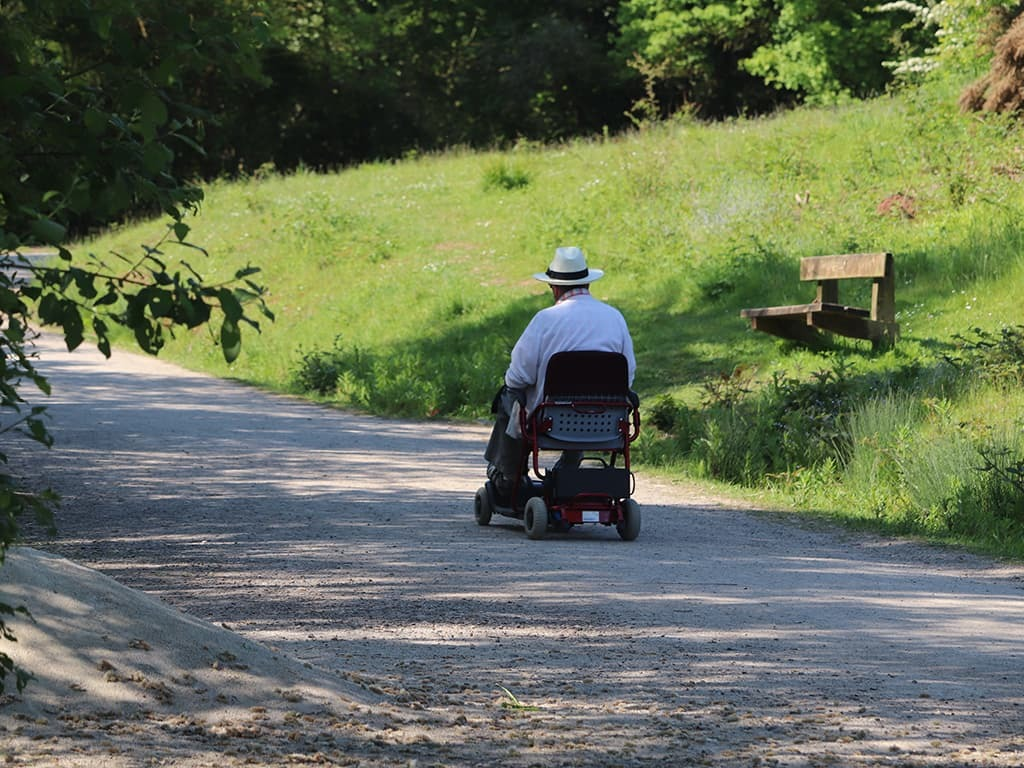 ALS patient using a mobility scooter